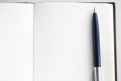 Notepad for writing text. Pen and notepad for writing text Stock Photos