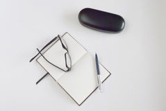 Notepad for writing text. Pen, glasses and notepad for writing text Royalty Free Stock Photo