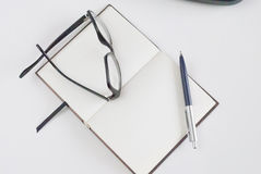 Notepad for writing text. Pen, glasses and notepad for writing text Royalty Free Stock Photography