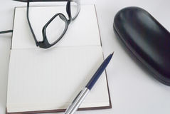 Notepad for writing text. Pen, glasses and notepad for writing text Royalty Free Stock Photos
