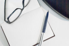 Notepad for writing text. Pen, glasses and notepad for writing text Royalty Free Stock Images