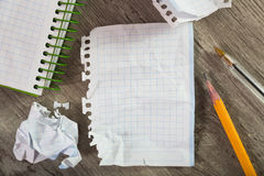 Notepad with writing utensils Royalty Free Stock Images