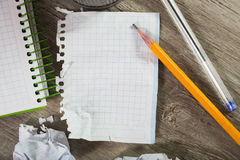 Notepad with writing utensils Stock Images