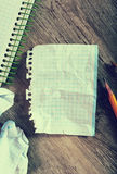 Notepad with writing utensils Royalty Free Stock Image
