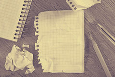 Notepad with writing utensils Stock Image