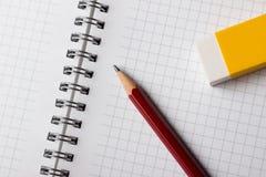 Notepadblyertspenna och radergummi Fotografering för Bildbyråer