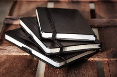 Notepads on brown wood table Royalty Free Stock Photography