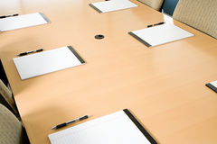 Notepads on conference table royalty free stock photography