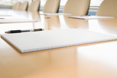 Notepads on conference table Stock Images
