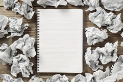 Notepads and crumpled paper Stock Photography