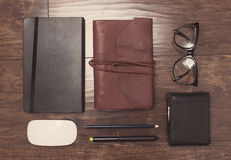 Notepads in leather cover with pencils and eyeglasses Stock Photography