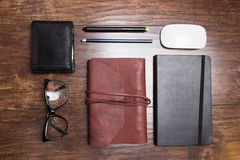Notepads in leather cover with pencils and eyeglasses Stock Photo