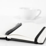 Notepads with pen and coffee Royalty Free Stock Photography