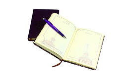Notepads and pen. On a white background is an indoor and outdoor diary, on which lies the pen Stock Photos