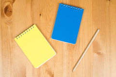 Notepads and pencil. On wooden office desk Stock Photos