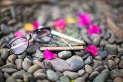 Notepads plans and sunglasses on a gravel road to Stock Images