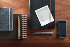 Notepads and polaroid film Stock Photo