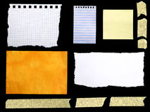 Notepaper. Pieces of paper isolated on black background stock photos