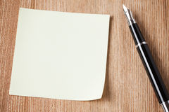Notepaper and black pen Royalty Free Stock Photography