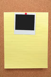 Notepaper and blank photo Royalty Free Stock Photo