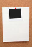 Notepaper and blank photo. Corkboard, notepaper and blank photo Royalty Free Stock Images