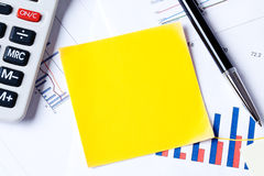 Notepaper on business plan. Photo shot of notepaper on business plan Royalty Free Stock Photography