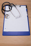Notepaper on a clipboard with a stethoscope Royalty Free Stock Photo