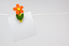 Notepaper with flower pin Stock Image