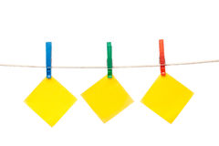 Notepaper hanging on clothesline Stock Images