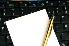 Notepaper on the keyboard Stock Photo