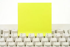 Notepaper and keyboard. Concept of communication Royalty Free Stock Photo