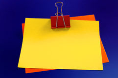 Notepaper and paperclips Stock Photo