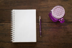 Notepaper, pen and drink on wooden table Stock Photos