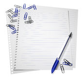 Notepaper with a pen and paper clips Royalty Free Stock Photography