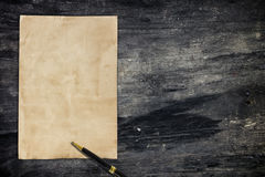 Notepaper and pen on wooden background Stock Photos