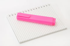 Notepaper and pink pen on the white background Stock Photos
