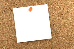 Notepaper pinned on cork board Royalty Free Stock Images