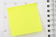 Notepaper sticking on calendar. Blank notepaper sticking on calendar Royalty Free Stock Images