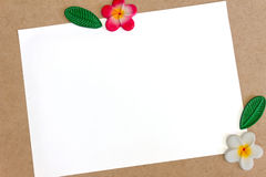 Notepaper. White notepaper and flower on wooden table Royalty Free Stock Photos