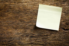 Notepaper on wooden background Stock Photos