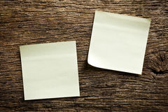 Notepaper on wooden background Stock Photography