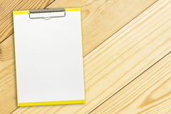 Notepaper on wooden background Royalty Free Stock Photos