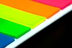 Notes. Different coloured notes with a black background Royalty Free Stock Image