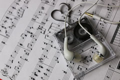 Notes background and headphones Stock Photography