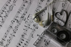 Notes background and headphones Stock Images