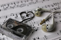 Notes background and headphones Royalty Free Stock Photography