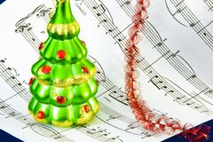 Notes and Christmas balls. Christmas sounds motive stock images