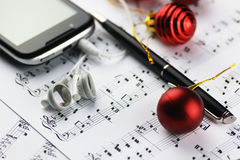 Notes and Christmas balls Royalty Free Stock Photos