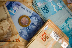 Notes and Coins of Brazil. Real Notes and coins, the official currency of Brazil royalty free stock photos