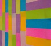 Notes collantes colorées comme fond Photographie stock libre de droits